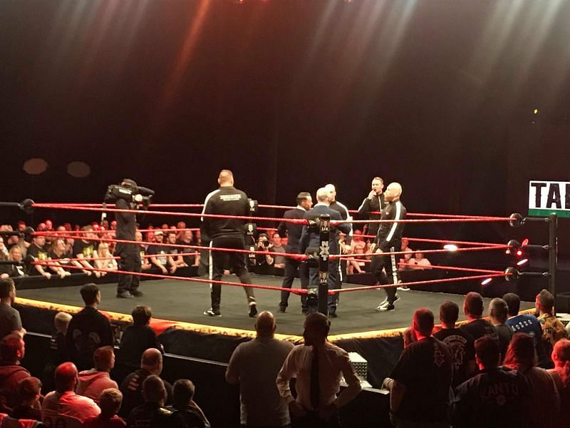 Imperium surrounded Johnny Saint but was soon confronted by Tyler Bate