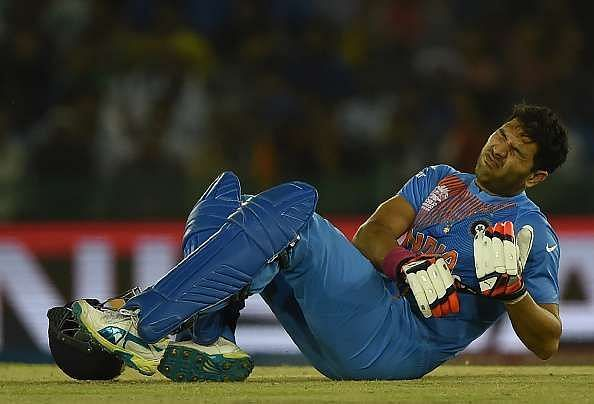 Yuvraj Singh grimaces in pain during the game against Australia