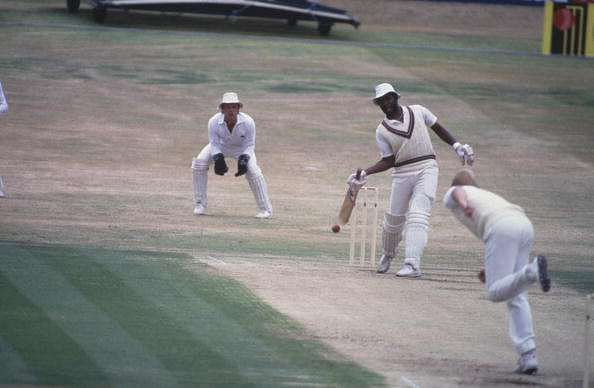 Malcolm Marshall tries to bat with one hand