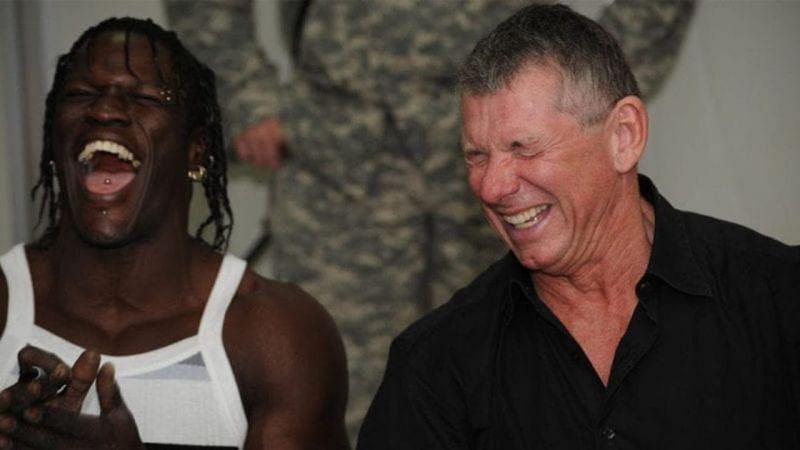Vince McMahon and R-Truth laughing at a Baron Corbin promo, probably