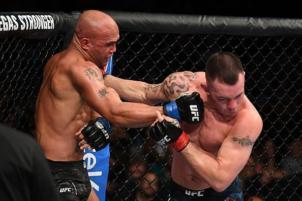 Robbie Lawler attempts to punch Colby Covington