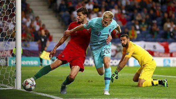 Van de Beek (right) fights for the ball in Netherlands