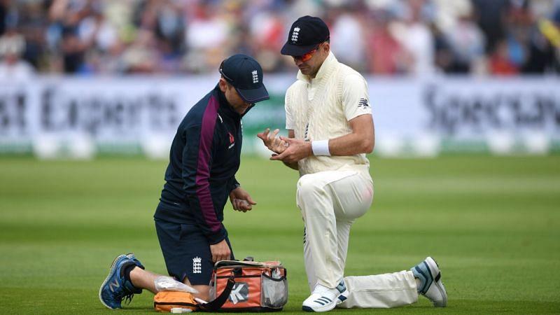 James Anderson receives treatment at Edgbaston