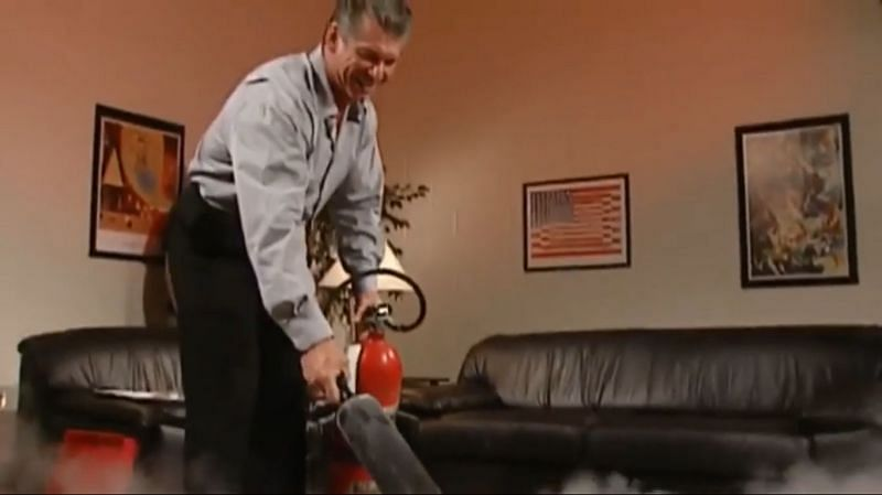 Vince spraying Ross with a fire extinguisher