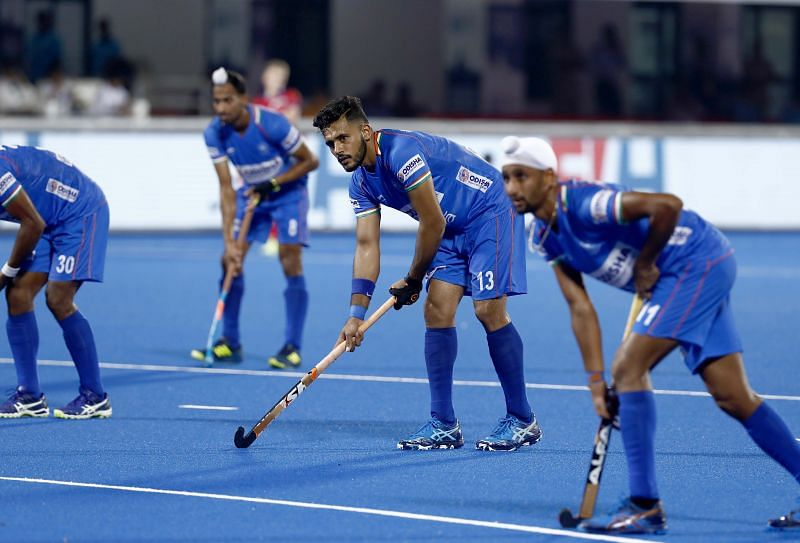 Harmanpreet Singh (centre) preparing to take a Penalty Corner