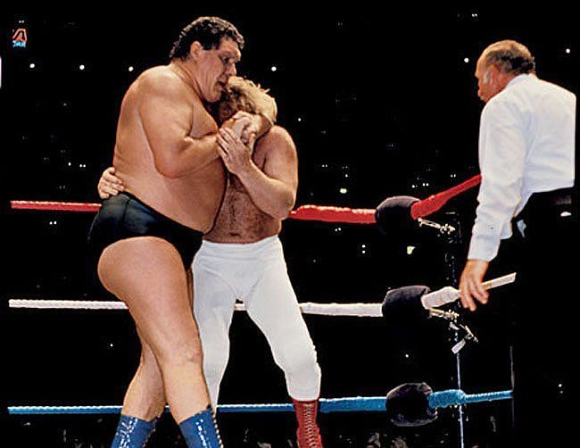 Andre the Giant traps Big John Studd in a head lock
