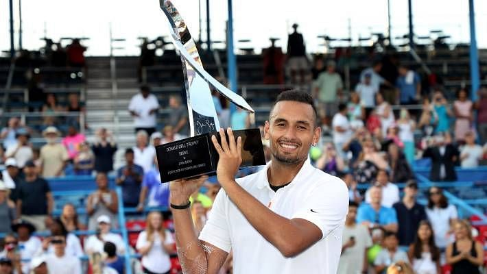 Nick Kyrgios poses with the 2019 ATP 500 Citi Open trophy