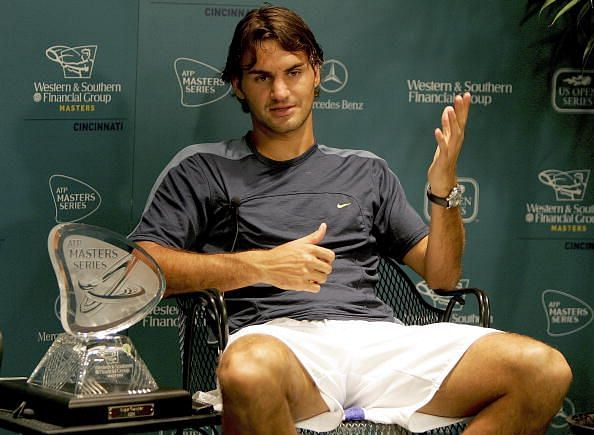 Federer poses with his 8th Masters 1000 title at 2005 Cincinnati