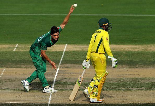Usman Shinwari bowling against Australia