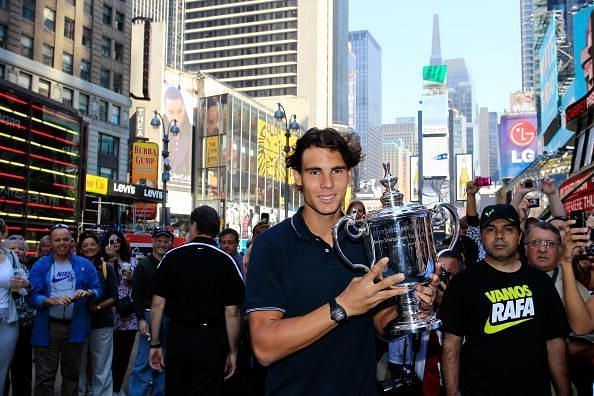 Nadal poses with his first US Open title in 2010