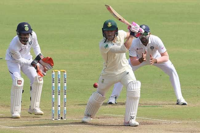 Faf du Plessis punches through covers.