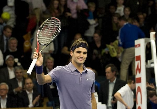 Federer celebrates a win in his 900th match on tour, at 2010 Stockholm