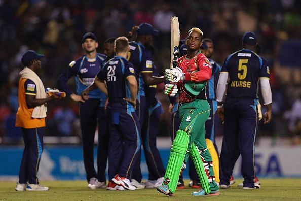 Hetmyer walking back to the pavilion with disappointment
