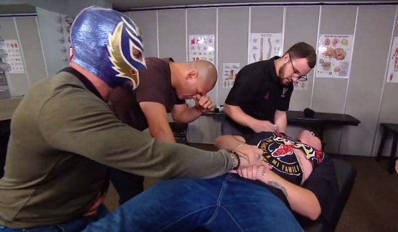Rey Mysterio and Cain Velasquez with Mysterio