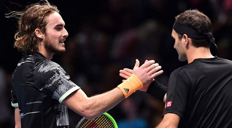 Tsitsipas greets Federer at the net following his semifinal victory over the 20-time Grand Slam winner