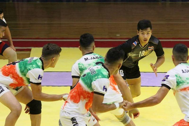 Hosts Iran u-20 kabaddi team defending against Thailand