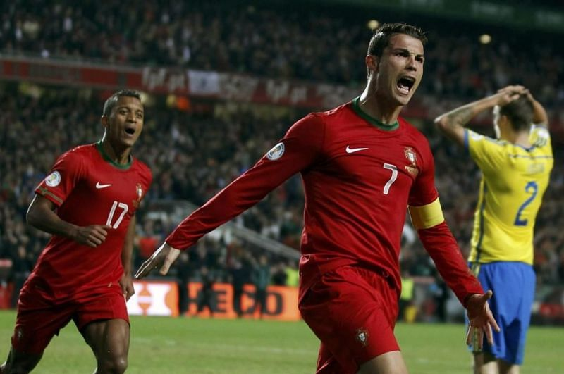 Cristiano Ronaldo exults after scoring in a 2014 FIFA WC qualifier playoff against Sweden