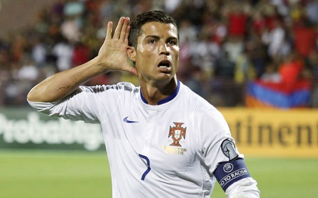 Cristiano Ronaldo takes in the applause after scoring against Armenia.