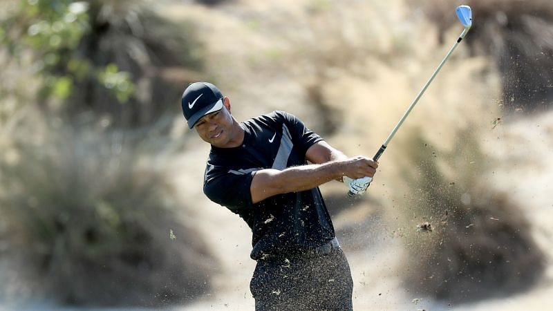 Tiger Woods suffers late collapse as Woodland and Reed ...