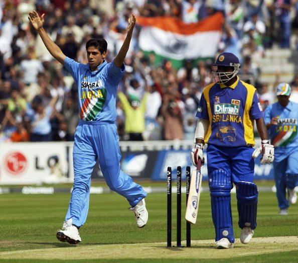 Ashish Nehra of India celebrates the wicket of Sanath Jayasuriya of Sri Lanka