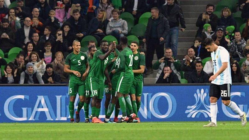 Nigerian players celebrate a goal against Argentina