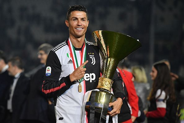 Cristiano Ronaldo poses with his first Serie A title