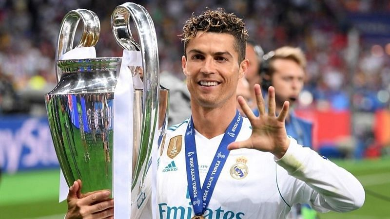 Cristiano Ronaldo poses with his 5th Champions League title