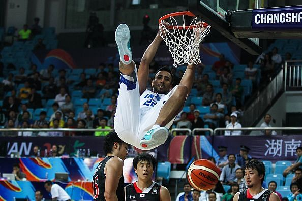 Amjyot Singh finishes a dunk during India