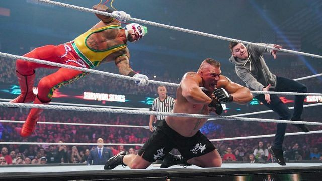 Rey Mysterio and Dominik hit Brock Lesnar with a double 619!