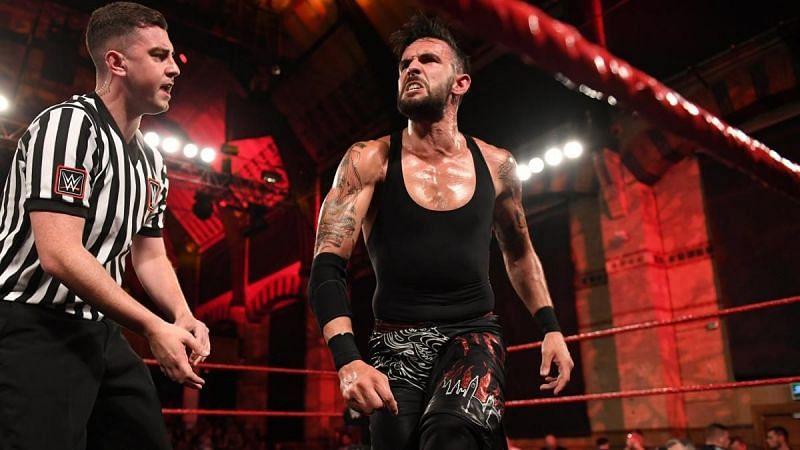 Eddie Dennis with NXT UK referee Thomas Kearins