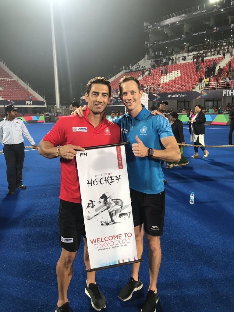Wayne Lombard (in red shirt) after Indian team