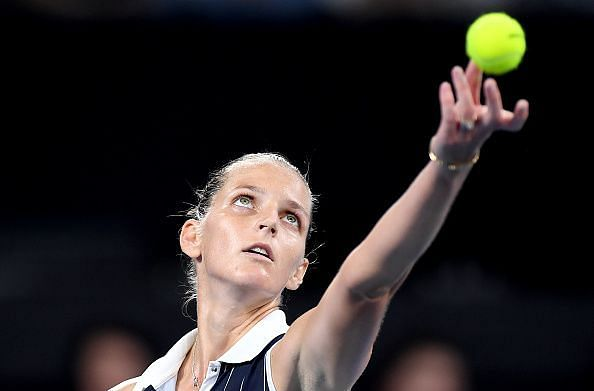 Karolina Pliskova has kept her title defence alive in face of extreme adversity.