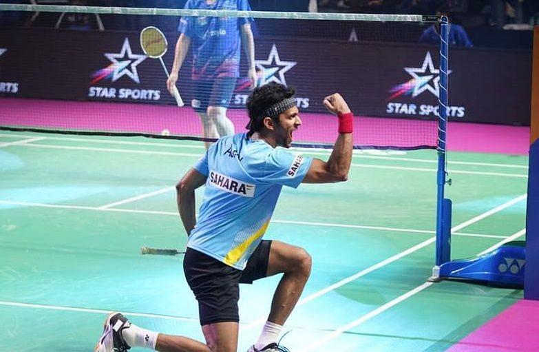 Ajay Jayaram celebrates after winning his Men