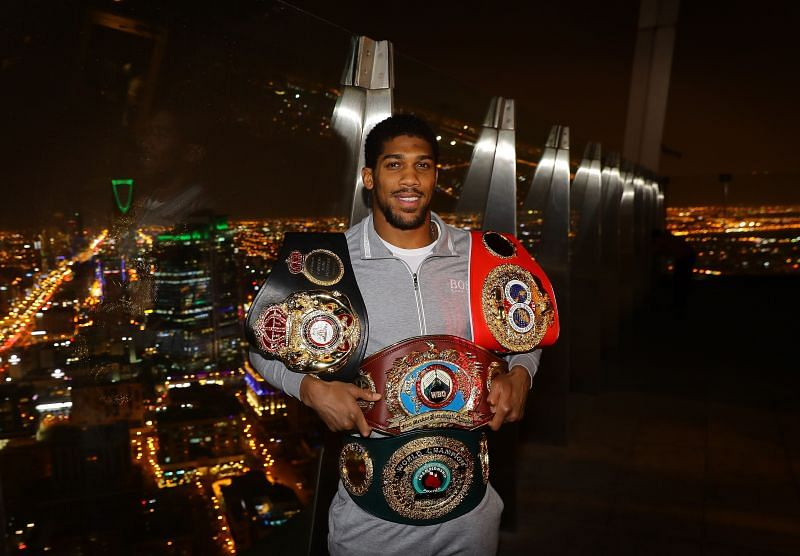 Anthony Joshua holds the other belts