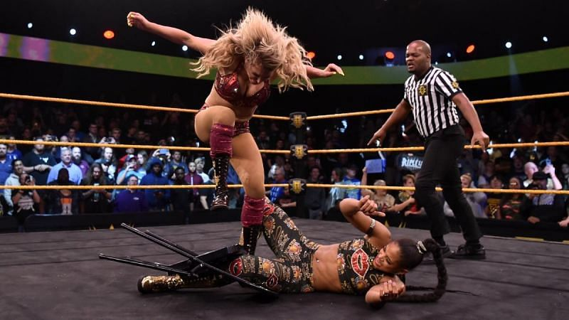 Charlotte Flair viciously attacking Bianca Belair