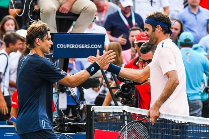 Ferrer (left) lost to Federer for the 17th time at the 2017 Coupe Rogers