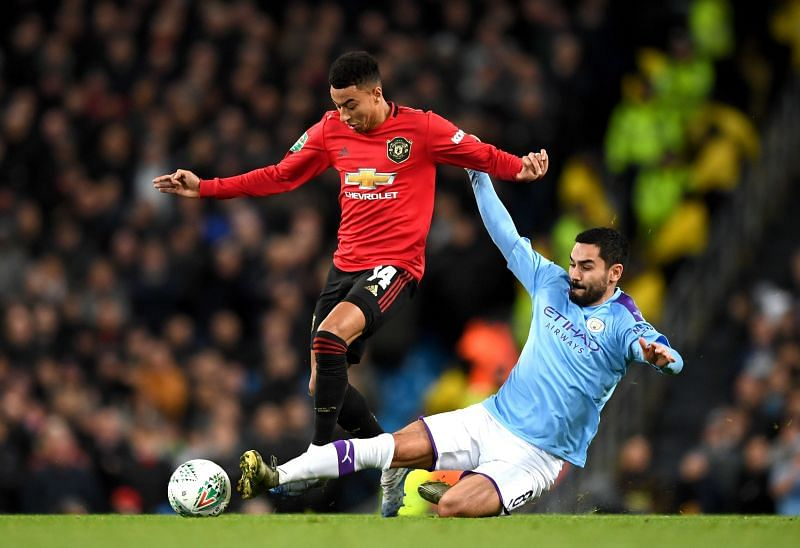 Jesse Lingard with Ilkay Gundogan