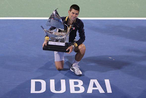 Djokovic celebrates his 4th Dubai title in 2013