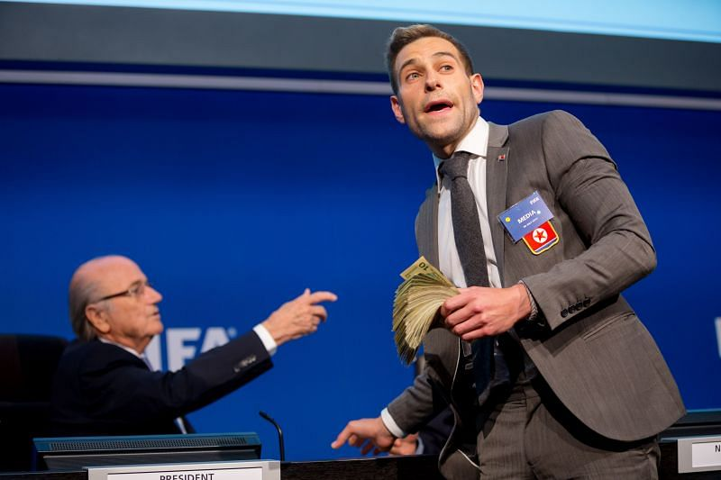 FIFA President Sepp Blatter (left) is heckled prior to a press conference by Simon Brodkin AKA Lee Nelson