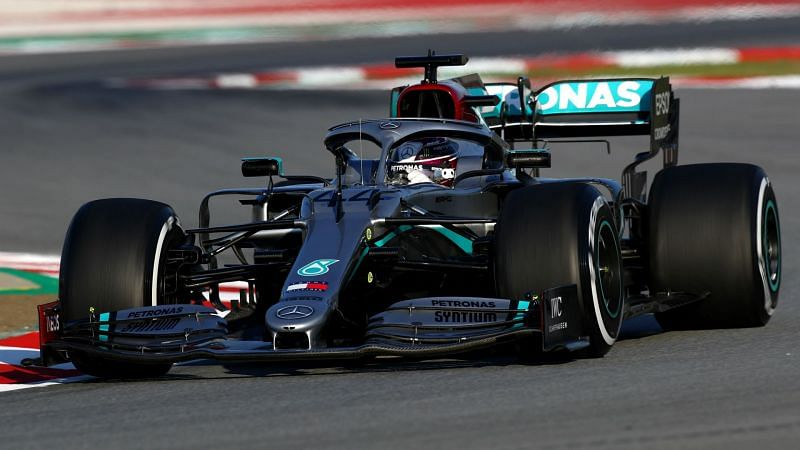 Lewis Hamilton drives the new Mercedes - cropped
