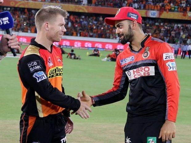 David Warner with Virat Kohli