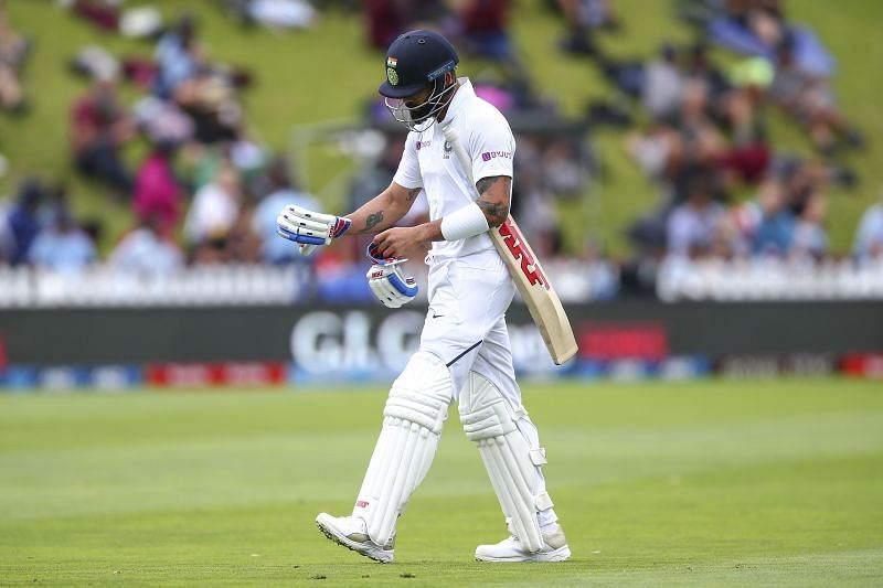 Virat Kohli walks back to the pavilion crestfallen