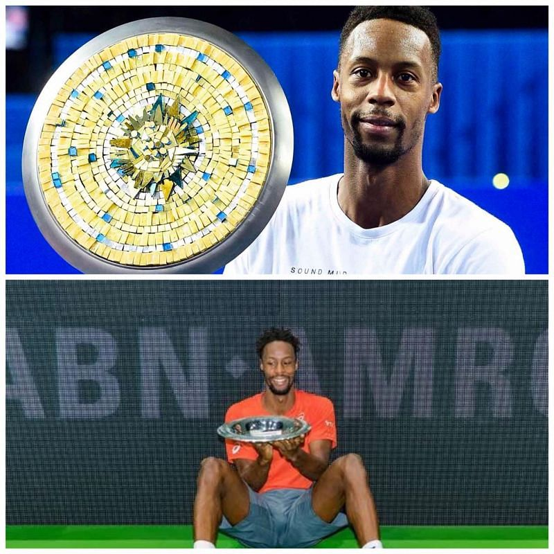 Monfils poses with his Montpellier (top) and Rotterdam trophies