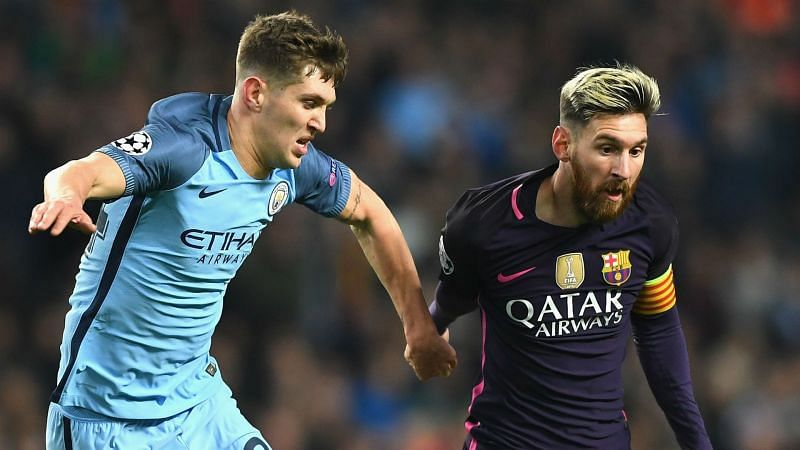 John Stones and Lionel Messi - cropped