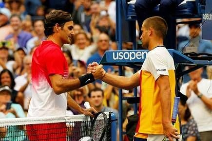 Federer (right) beat Youzhny for the 17th time at the 2017 US Open