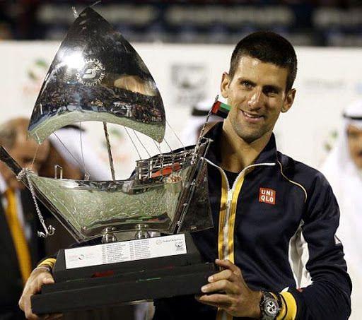Djokovic lifts his 4th Dubai title in 2013 Djokovic celebrates his 5th Dubai title