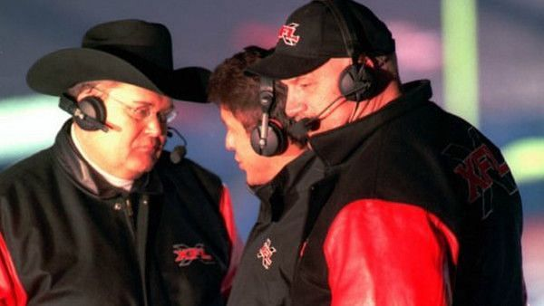 Jim Ross, some guy, and Jesse Ventura at an original XFL game