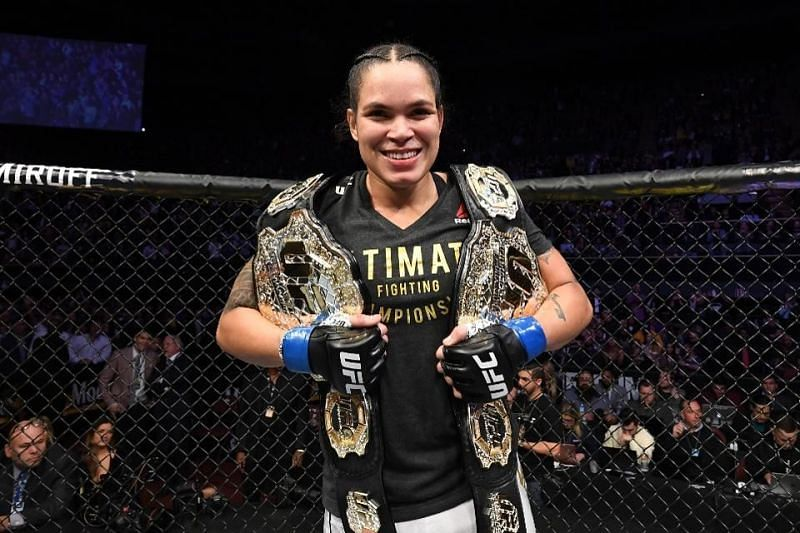 Amanda Nunes with her two Championship belts