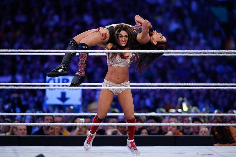 Nikki beats Brie in the age department.