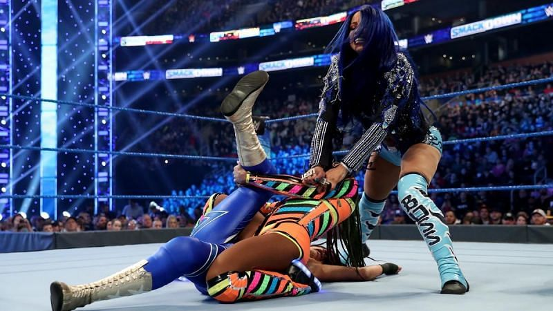 Sasha caused the match to end in DQ